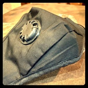 Black mask with adjustable ear strap